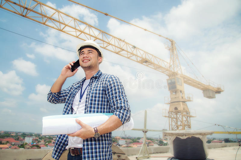 View of a Worker and architect watching some details on a construction and Contact by phone. royalty free stock photos