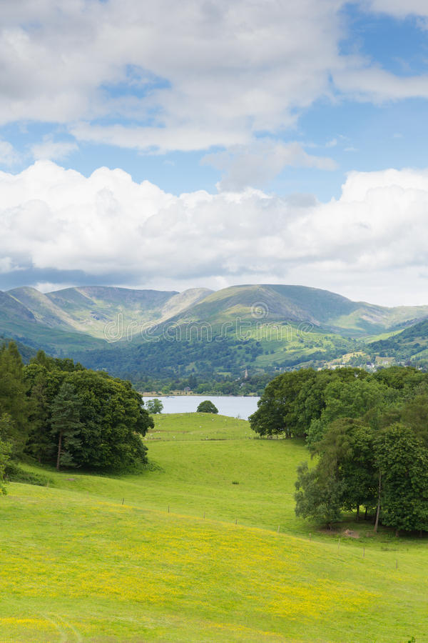 View from Wray Castle of Langdale Valley and mountains Lake District Cumbria uk. Country scene Langdale Valley and Fairfield Horse mountains from Wray Castle royalty free stock image