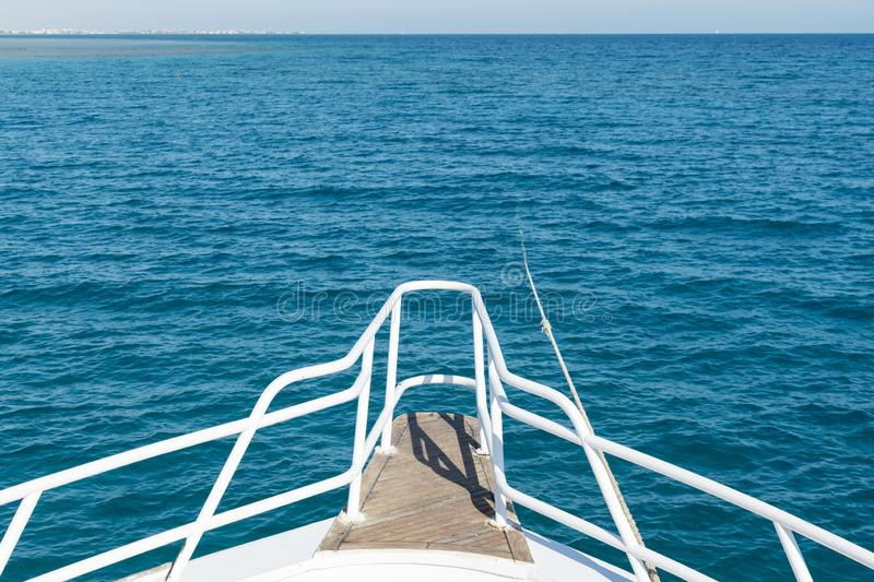 View from the yacht to the open sea. Ship in open sea is showing the bow in a summer day royalty free stock image
