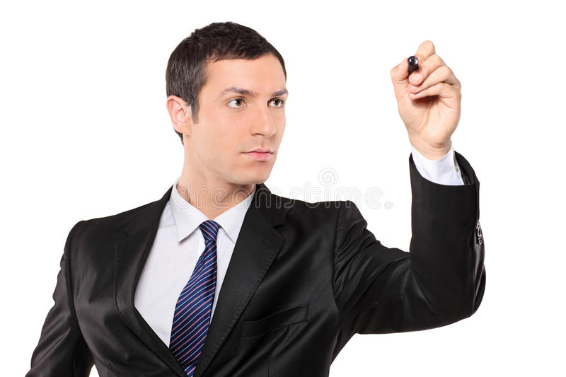 View of a young businessman holding a pen royalty free stock photography