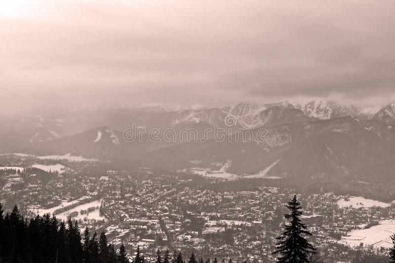 View of Zakopane and Tatra Mountains from Gubalowka in the winter in snowing weather stock photography