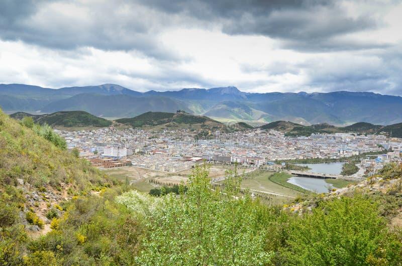 View of Zhongdian, better known as Shangri-La. Shangri-La with surrounding mountins, Yunnan, China stock photos