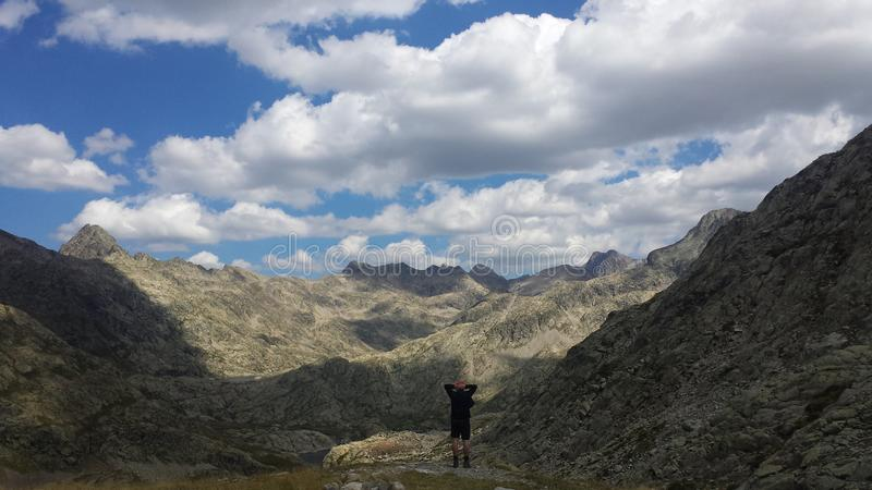 Viewing absorbed the mountainous landscape stock photos