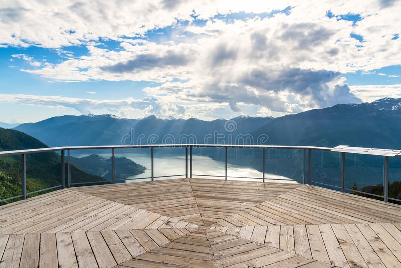 Viewing Desk on the Top of a Mountain Overlooking a Fjord on a Summer Day. Deserted Viewing Platform on the Top of a Mountian Overlooking a Magnificent Fjord stock photo