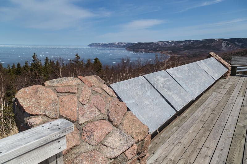 Viewing Platform at Cabot Trail. Wooden viewing platform overlooking the Atlantic Ocean in spring on the Cabot Trail in Nova Scotia, east coast Canada. Chunks of stock image