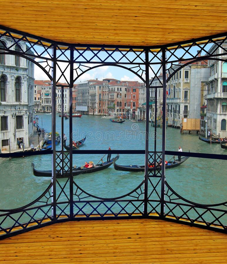 Viewing platform overlooking the canal grande venice river gondolas. Photo of a viewing platform overlooking the canal grande river in venice italy with gondolas royalty free stock images