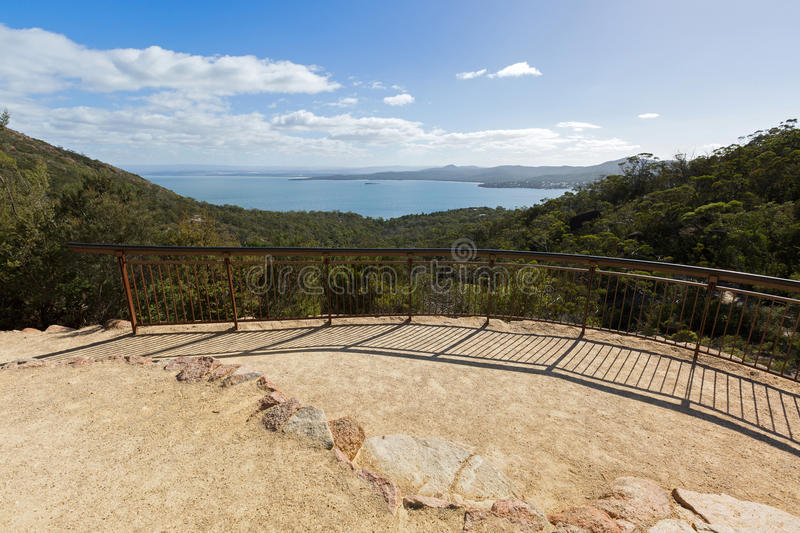 Viewing platform overlooking Coles Bay, on Wineglass Bay track i. Metal fence embedded in cliff at viewing platform overlooking Coles Bay, on Wineglass Bay track royalty free stock image