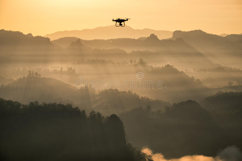 Viewpoint golden sunshine mist mountain with drone aircraft stock photography