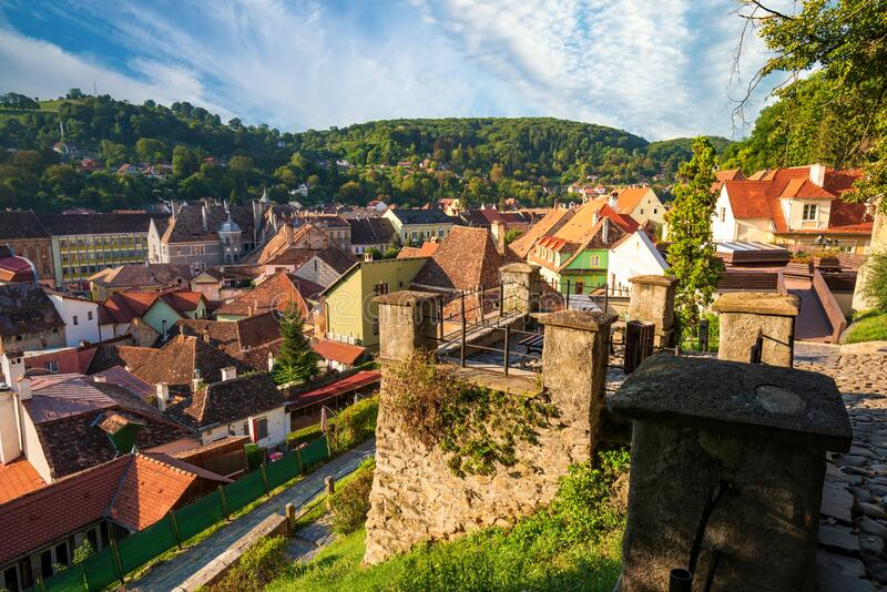 Viewpoint on hillside of medieval fortified city of Sighisoara, Transylvania region, Romania. Birthplace of Vlad Dracula. UNESCO world heritage site, pavement stock photography