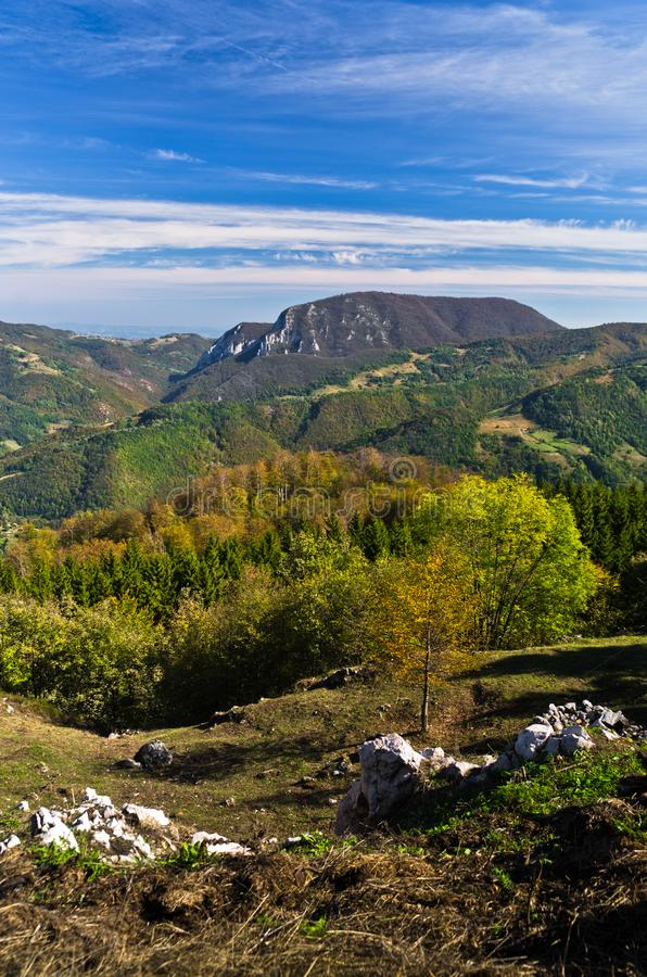 Viewpoint on a landscape of mount Bobija, hills, haystacks, meadows and colorful trees royalty free stock image