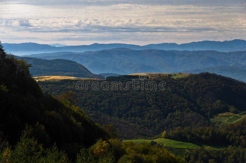Viewpoint on a landscape of mount Bobija, hills, meadows and colorful forests royalty free stock image