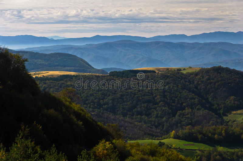 Viewpoint on a landscape of mount Bobija, hills, meadows and colorful forests royalty free stock photography