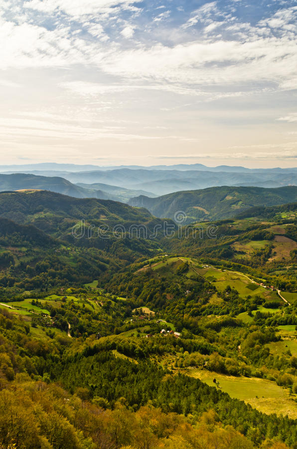 Viewpoint on a landscape of mount Bobija, peaks, hills, meadows and green forests stock photography