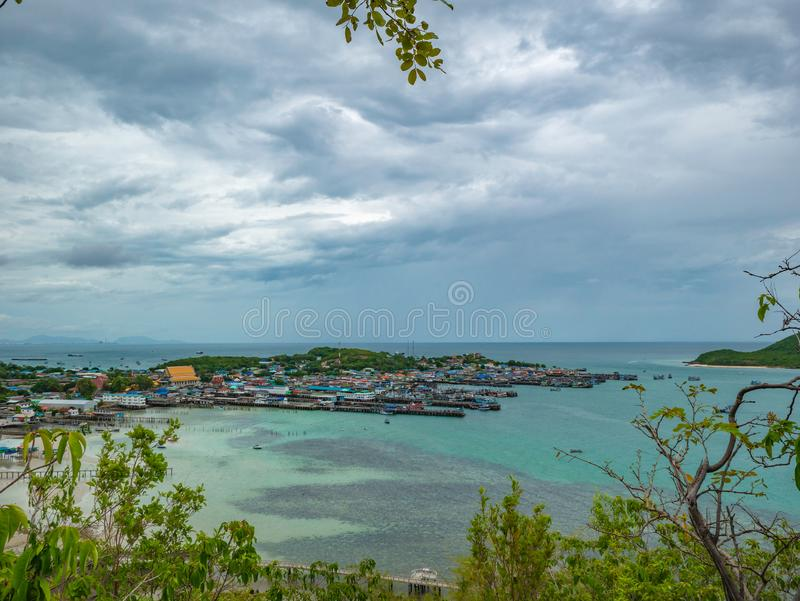 ViewPoint on the mountain with Fisherman townscape with idyllic ocean and rainy cloud sky in vacation time. Chonburi thailand,holiday concept royalty free stock photography