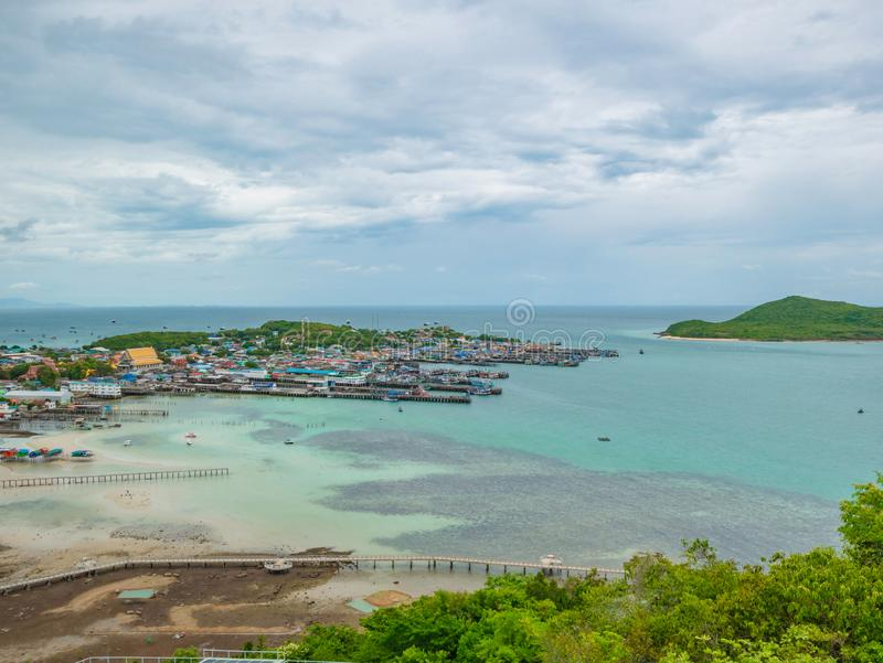 ViewPoint on the mountain with Fisherman townscape with idyllic ocean and rainy cloud sky in vacation time. Chonburi thailand,holiday concept stock photography