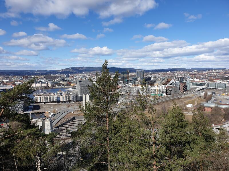 Viewpoint from Oslo city in Norway. There are in spring and a few flakes of snow on the mountain. A lot of tourists travel there to see the city royalty free stock images