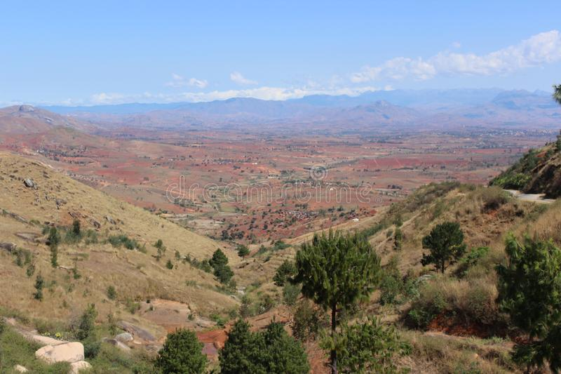 Viewpoint over Ambalavao, Madagascar. Viewpoint looking out over mountains and fields at Ambalavao, Madagascar royalty free stock photos