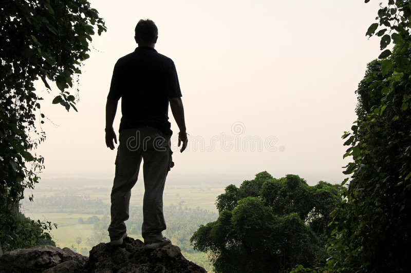 Viewpoint silhouette. Man's silhouette at a viewpoint overlooking central Thailand stock photos