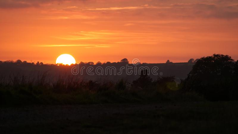 Sunset over farmland in the west of England. Views across South Cornwall as the nights begin to get longer and the air temperature lowers stock photo
