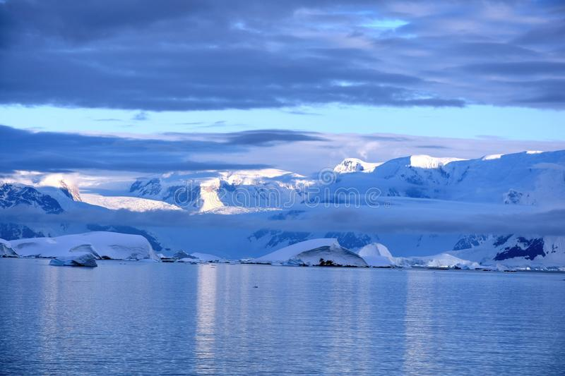 Views of the Antarctic Peninsula. At dusk near the Lemaire Channel royalty free stock photography
