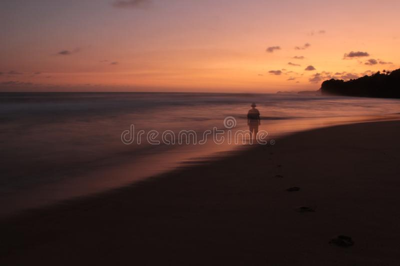 Views of the beach in the afternoon with colorful skies. View of the beach in the afternoon with colorful skies. with a smooth view of the waves stock images