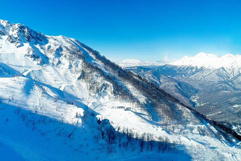 Views of beautiful snowy mountain and blue clear sky in ski resort. Views of beautiful snowy mountain and blue clear sky in ski resort . Good weather royalty free stock image