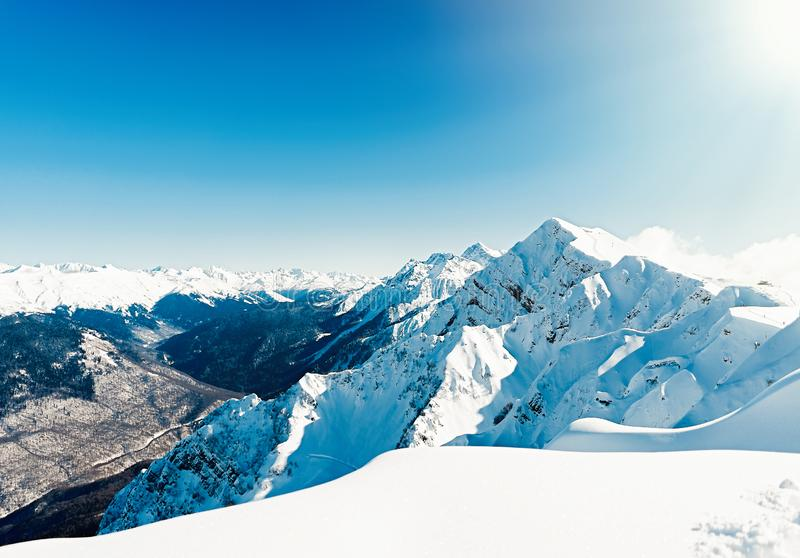 Views of beautiful snowy mountain and blue clear sky in ski resort. Views of beautiful snowy mountain and blue clear sky in ski resort . Good weather royalty free stock photo