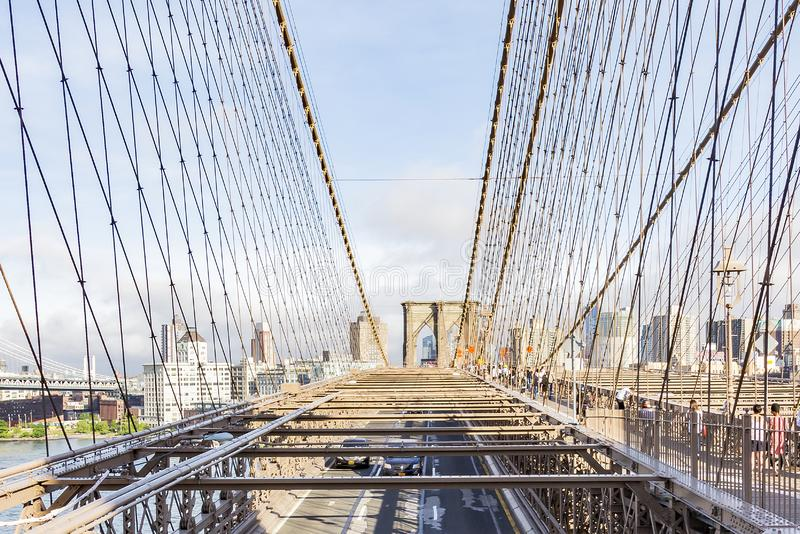 Views of the city part Brooklyn between the steel cables of the Brooklyn Bridge, New York, United States stock images