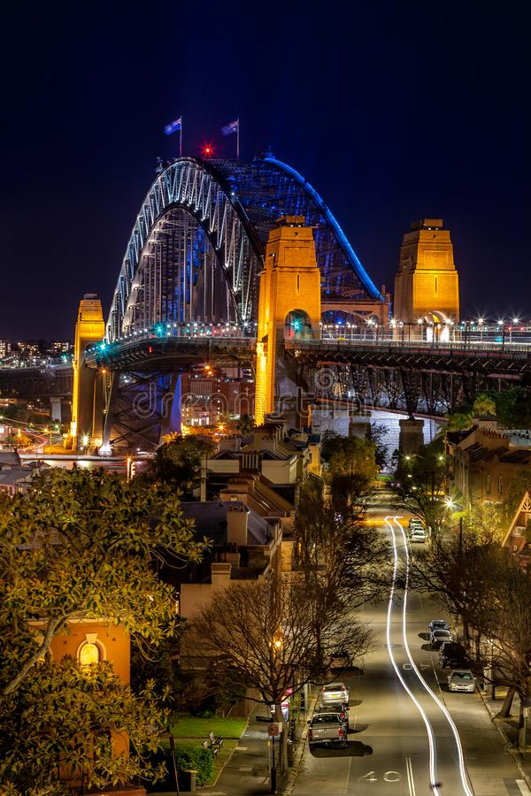 Views down the road towards Sydney Harbour Bridge at night stock image