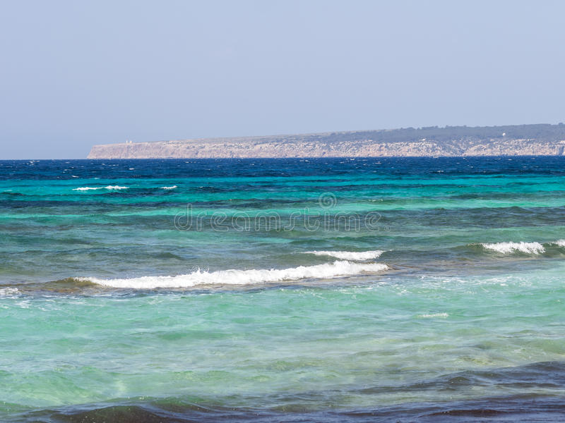 Views of the Formentera coast. Blue waters of the Formentera island royalty free stock image