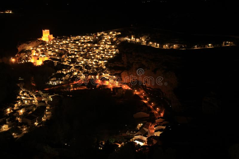 Views of the illuminated village of Alcala del Jucar at night from the viewpoint. In Spring stock photography