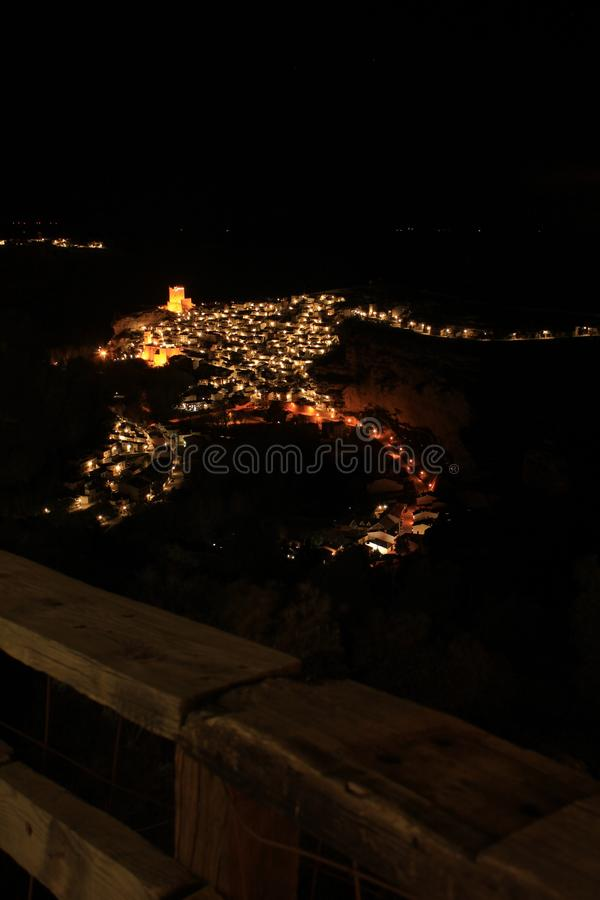 Views of the illuminated village of Alcala del Jucar at night from the viewpoint. In Spring royalty free stock photography