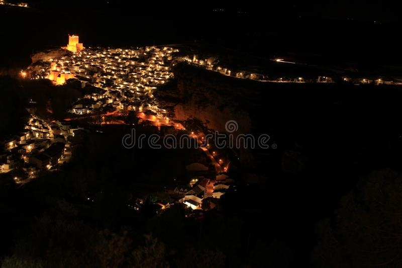Views of the illuminated village of Alcala del Jucar at night from the viewpoint. In Spring royalty free stock images