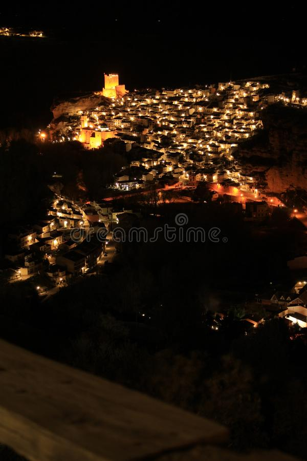 Views of the illuminated village of Alcala del Jucar at night from the viewpoint. In Spring stock photo