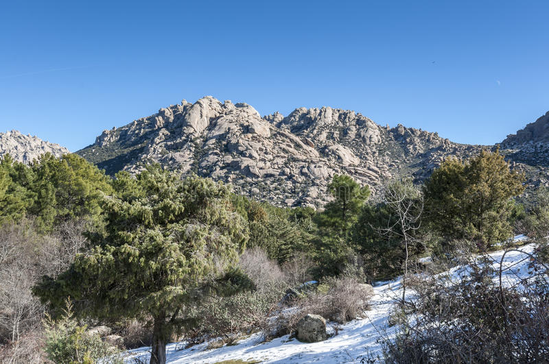 Views of La Pedriza, Madrid, Spain. Views of La Pedriza from Canto Cochino, in Guadarrama Mountains National Park, Madrid, Spain. Pena Sirio Peak can be seen in royalty free stock photography