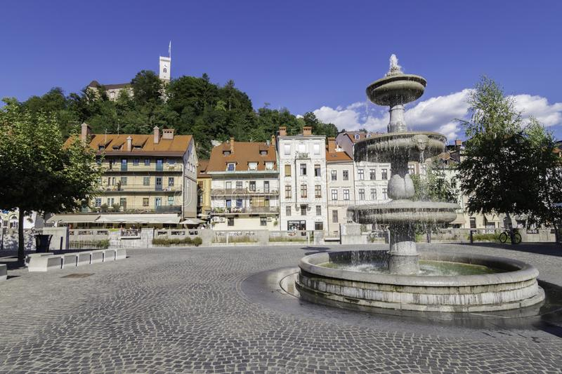 Views of Ljubljana Castle from Novi Square, with the fountain located in the center of the square in the foreground, Slovenia. Views of Ljubljana Castle from royalty free stock image