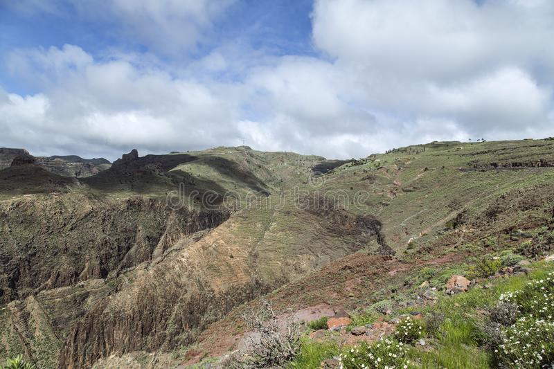 Views over the volcanic mountains of La Gomera. Beautiful almost untouched nature is one of the most important elements of La Gomera where many holiday goers royalty free stock image