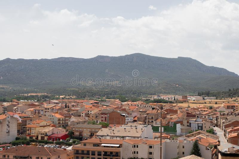 Views of the rooftops and mountain from the top of a small village, Valderrobres, Aragon, Spain. Views of the rooftops and mountain from the top of a small royalty free stock photo