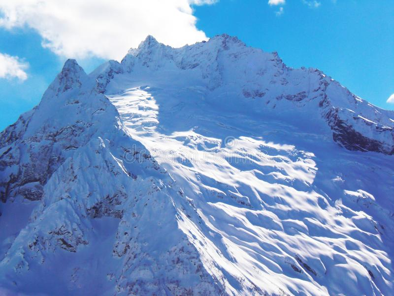 Views of snow capped mountains of Dombay. Winter Sunny day, mountain range, avalanche.  stock photos
