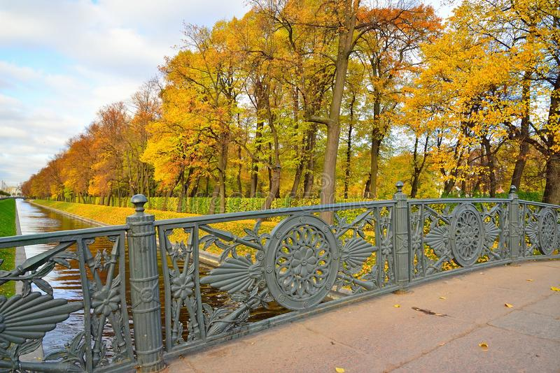 Views of the Swan groove and a Summer Garden with panteleymonovskiy bridge Sunny autumn day. St. Petersburg royalty free stock photography
