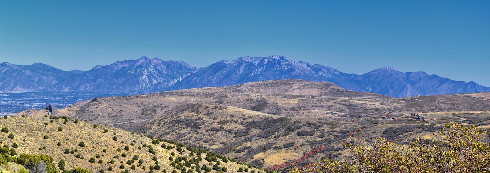 Views of Wasatch Front Rocky Mountains from the Oquirrh Mountains with fall leaves, Hiking in Yellow Fork trail Rose Canyon Utah stock photos