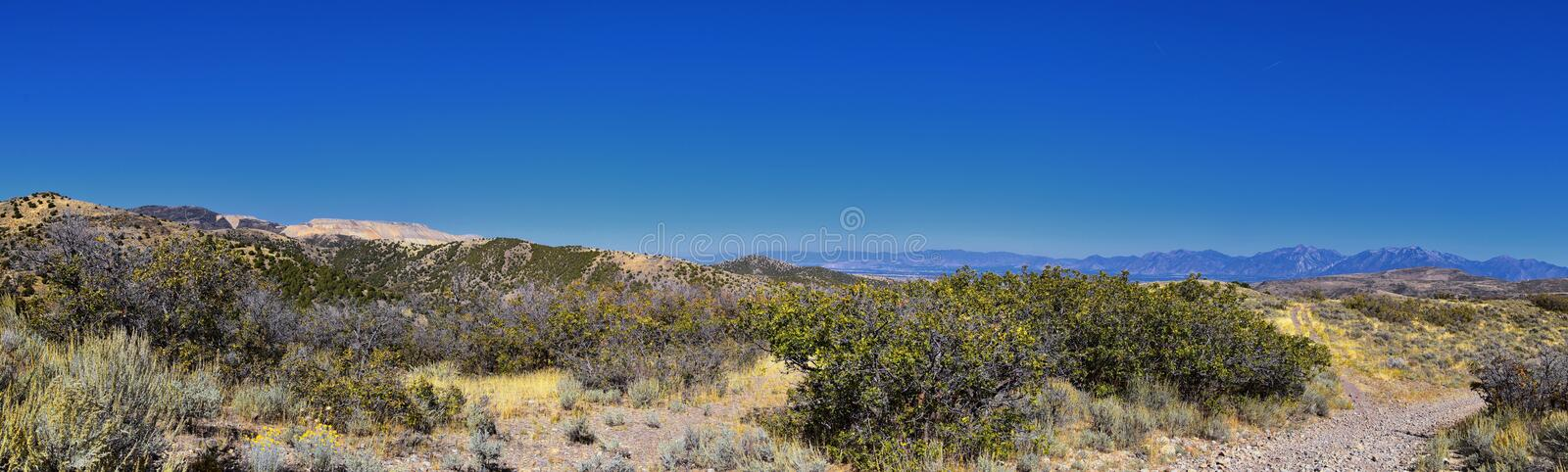 Views of Wasatch Front Rocky Mountains from the Oquirrh Mountains with fall leaves, Hiking in Yellow Fork trail Rose Canyon Utah royalty free stock images