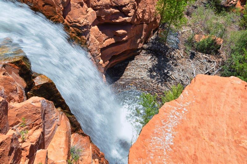 Views of Waterfalls at Gunlock State Park Reservoir Falls, In Gunlock, Utah by St George. Spring run off over desert erosion sands. Tone. United States stock photography