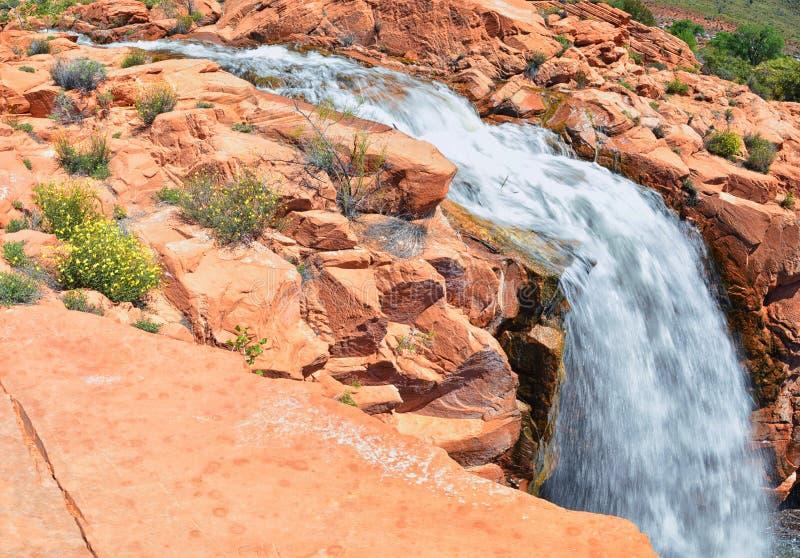 Views of Waterfalls at Gunlock State Park Reservoir Falls, In Gunlock, Utah by St George. Spring run off over desert erosion sands. Tone. United States royalty free stock images