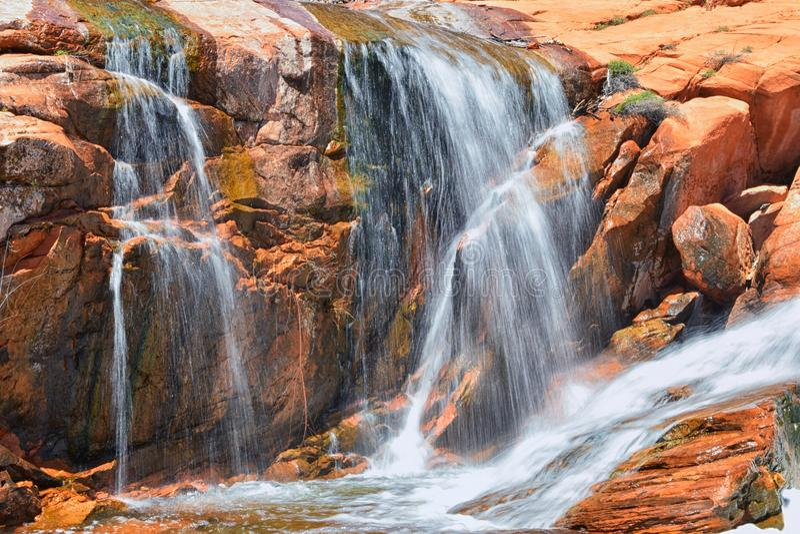 Views of Waterfalls at Gunlock State Park Reservoir Falls, In Gunlock, Utah by St George. Spring run off over desert erosion sands. Tone. United States royalty free stock photo
