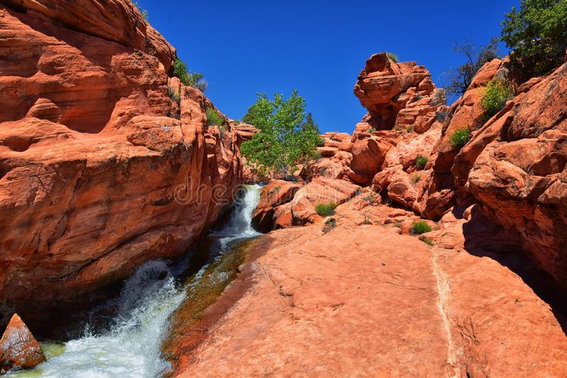 Views of Waterfalls at Gunlock State Park Reservoir Falls, In Gunlock, Utah by St George. Spring run off over desert erosion sands. Tone. United States royalty free stock photography