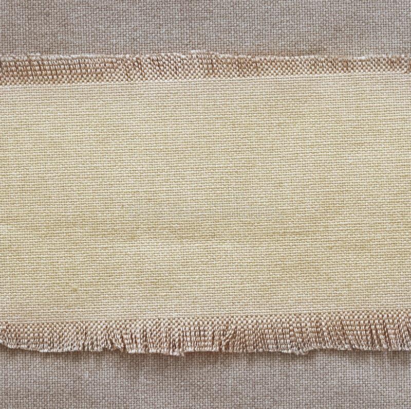 Vifta med säckvävbakgrund, stycke av naturligt material, kan användas som bakgrund royaltyfria foton