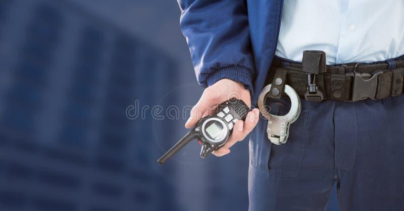 Vigilante de seguridad fuera de edificios azules del fondo imagen de archivo libre de regalías