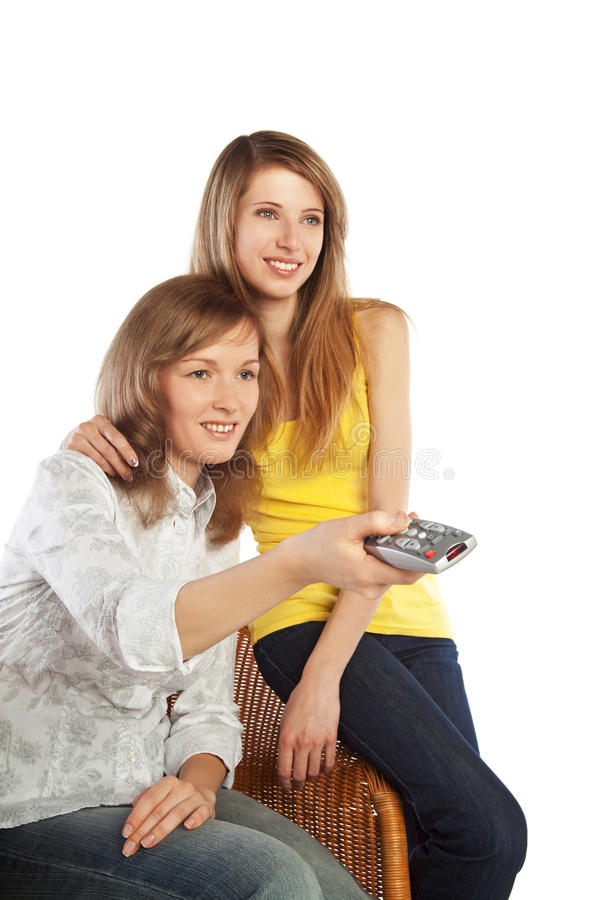 Vigilanza TV delle giovani donne immagine stock