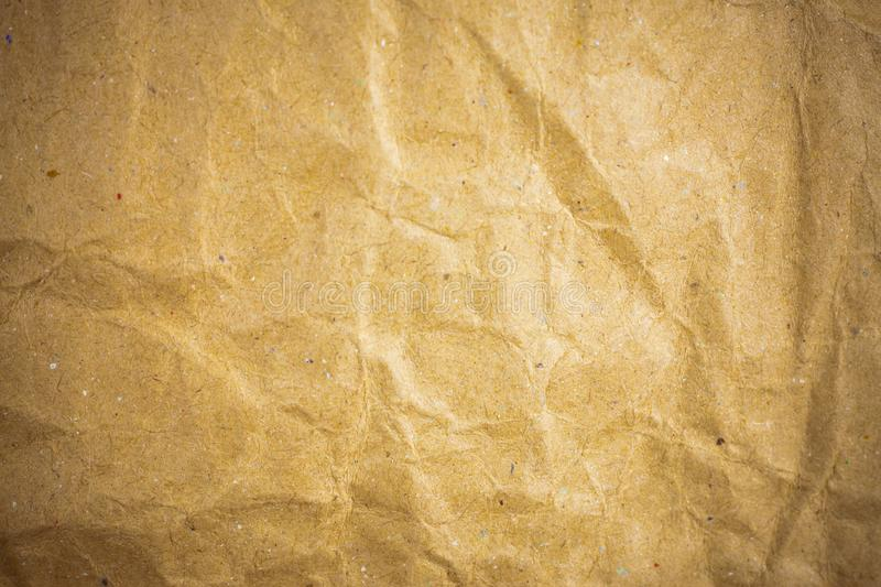 Vignette brown crumpled paper. Abstract, ancient, backdrop, background, blank, card, cardboard, color, crease, creased, damaged, design, detail, dirty, effect royalty free stock photos